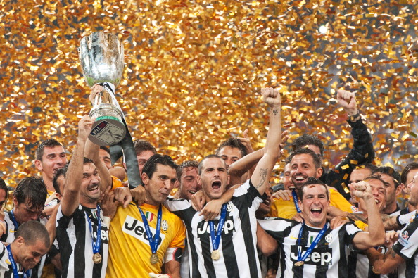 Juventus players celebrate their win aga
